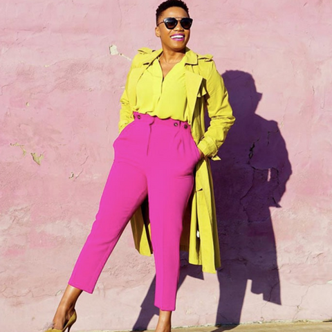 Lady wearing pink trousers and canary yellow coat