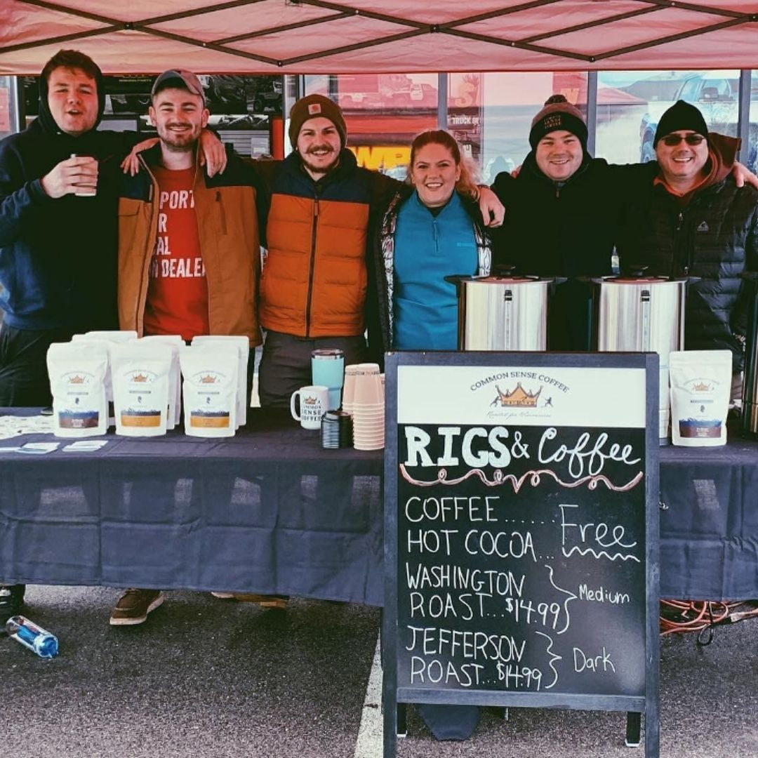 Our team posing for a picture at our first event called Rigs & Coffee. I'm the second one from the right