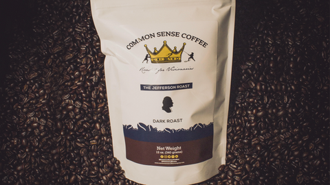 Common Sense Coffee's Jefferson Roast laying in a pile of coffee beans.