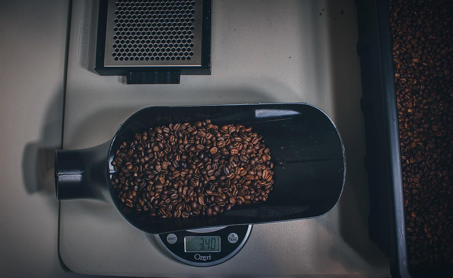 A coffee scale with 340 grams of Common Sense Coffee's Washington Roast on it. This was the company's first coffee to be sent to a customer.