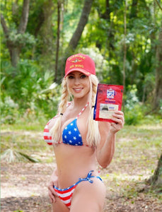 The US Marine Corps Veteran, model, and entrepreneur Dawn Jenn poses for a photo in her patriot bathing suit wearing a Marine Air Wing hat and holding a bag of RAH Coffee Company's MSR Tampa Roast.