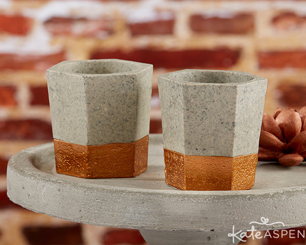 Geometric concrete tealight holders dipped in copper | Industrial wedding decor from Kate Aspen
