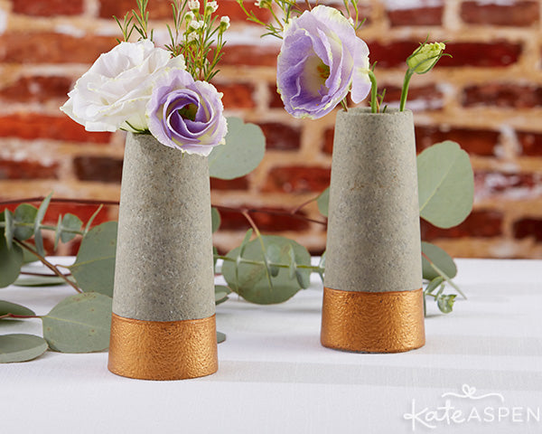 Concrete bud vases dipped in copper make pretty decor for an industrial wedding | Copper and Concrete collection from Kate Aspen