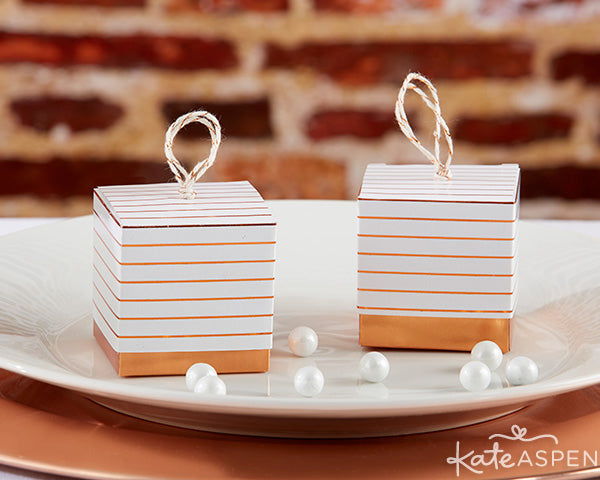 Striped Copper Foil Favor Boxes | Concrete bud vases dipped in copper make pretty decor for an industrial wedding | Copper and Concrete collection from Kate Aspen
