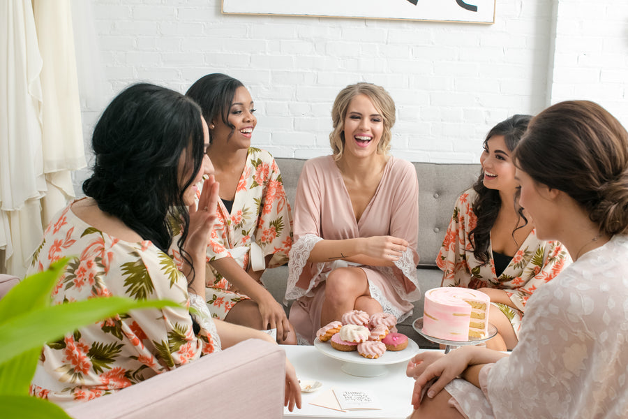 Bridal Party Laughing and Enjoying Food | Fun Tips For Getting Ready On Your Wedding Day | Kate Aspen