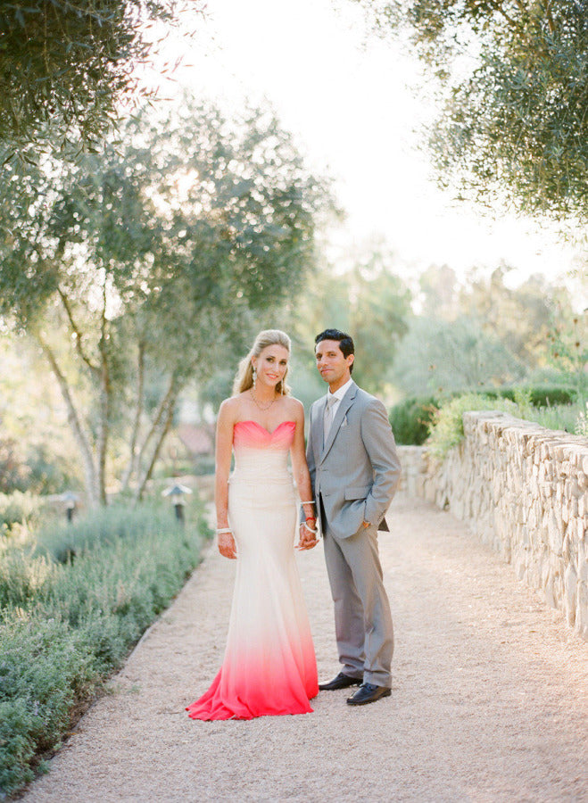 Bride in Pink Ombre Watercolor Wedding Dress with Groom in Gray Suit | Lacie Hensen Photography via Style Me Pretty