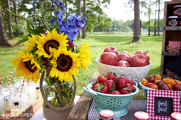 Barbecue picnic table with sunflowers, strawberries and apples
