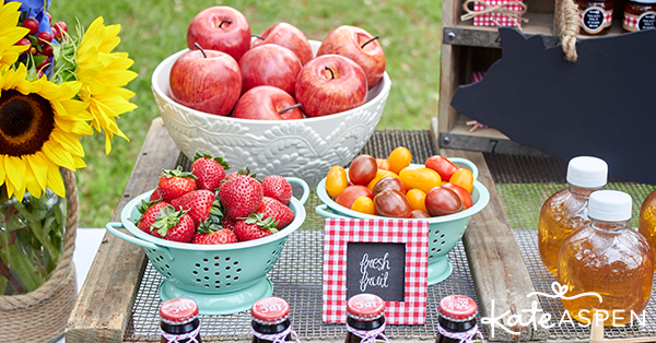 Barbecue picnic table with tomatoes, apples and strawberries