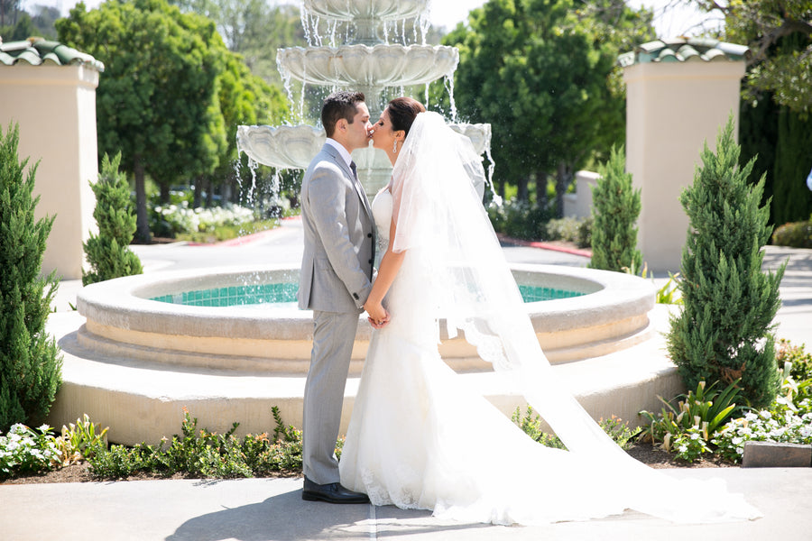 Bride and Groom Kissing | An Elegant Country Club Wedding | Kate Aspen