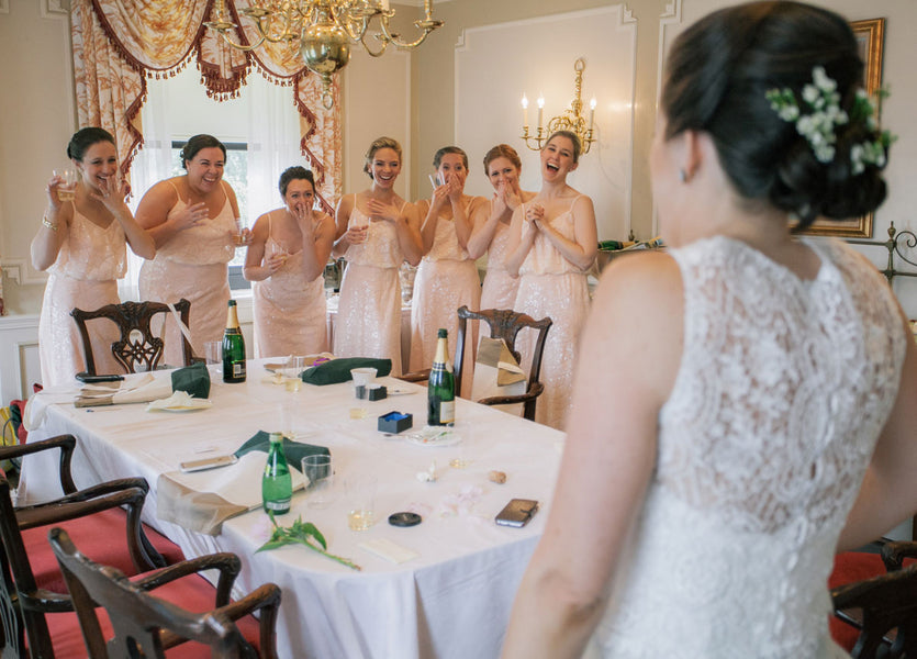 Bridesmaids Looking at Bride | A Spring Wedding in Delaware | Kate Aspen