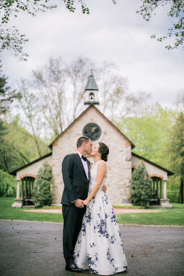 Kiss In Front Of Church | A Spring Wedding in Delaware | Kate Aspen
