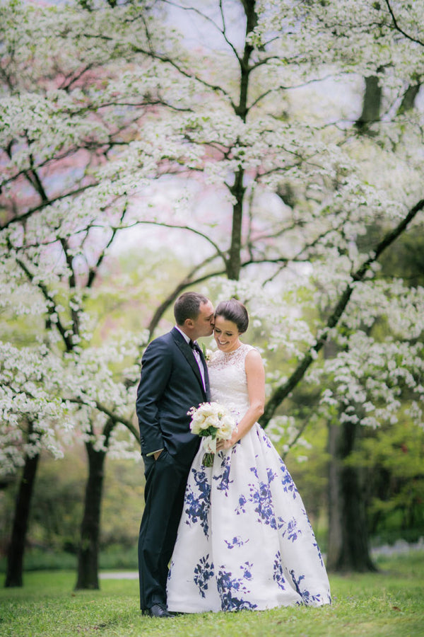 Groom Kissing Bride's Cheek | A Spring Wedding in Delaware | Kate Aspen