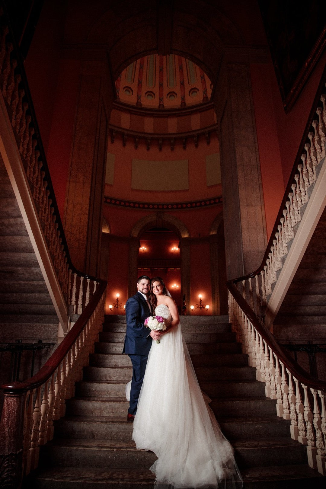 Bride and Groom On Stairs | A Gorgeous Grand Wedding in Ohio | Kate Aspen