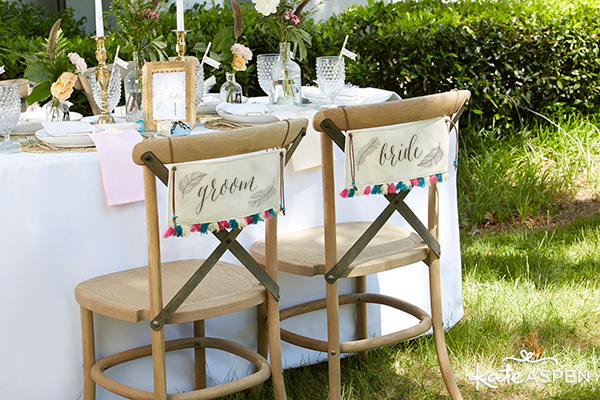 Bride and Groom Chair Signs with Feather Designs | Kate Aspen