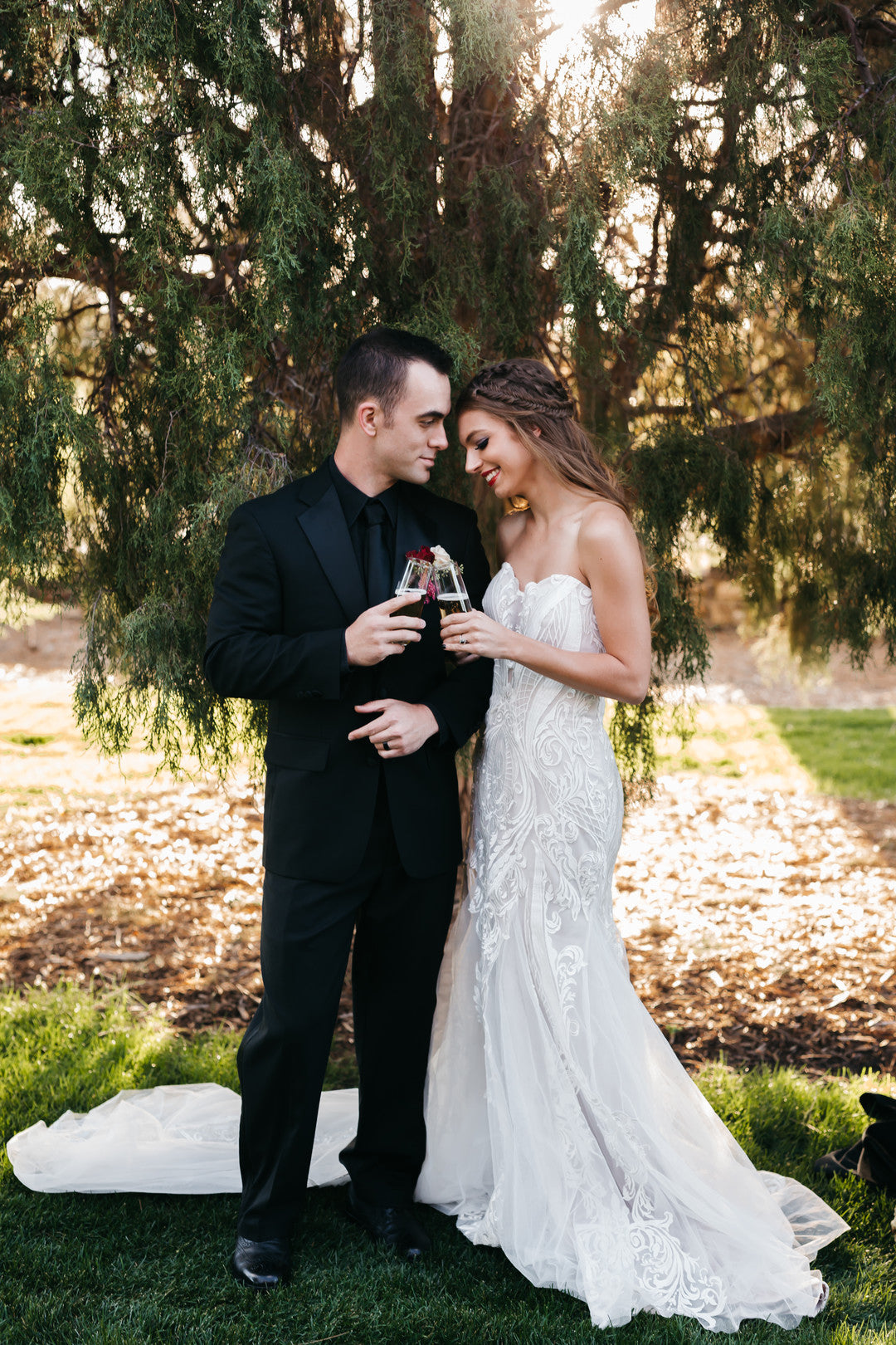 Bride And Groom Clinking Champagne Glasses | A Vintage Gothic Halloween Wedding | Kate Aspen