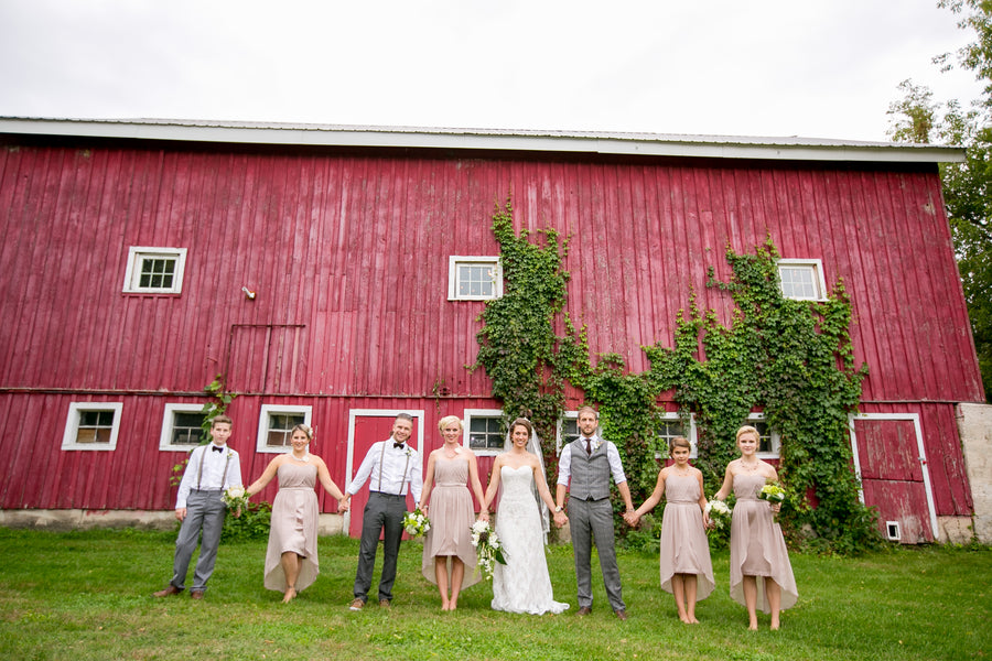 Bridal Party In Front of Red Barn | Elegant Barn Wedding | Jeannine Marie Photography