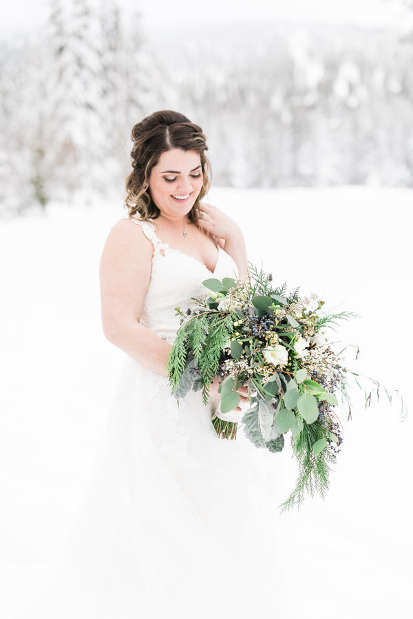 Bridal Photos Outside in the Snow | A Cozy Lake Tahoe Wedding | Kate Aspen