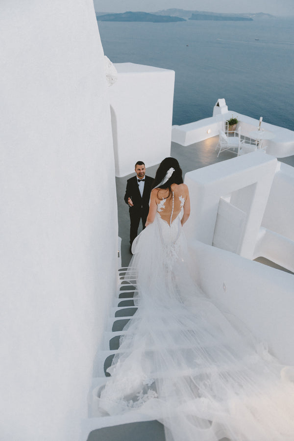 Bride Walks Down Stairs to Meet Groom | Santorini Destination Wedding | Vasilis Lagios Photography