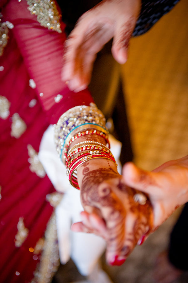 Bride Putting On Bangles | Fusion South Asian Wedding | Paris Mountain Photography