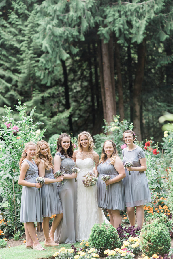 Bride With Bridesmaids in Dusty Purple Dresses | Blissful Garden Wedding Details | B. Jones Photography