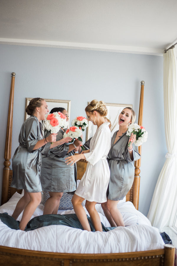 Bride and Bridesmaids Having Fun | Kennedy Grace Photography | Tips for the Perfect Beach Wedding | Kate Aspen