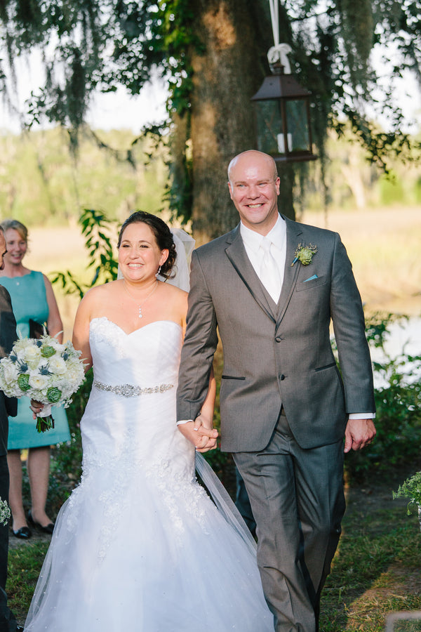 Bride and Groom Walk Down Aisle | Plantation Wedding in Charleston | Riverland Studios