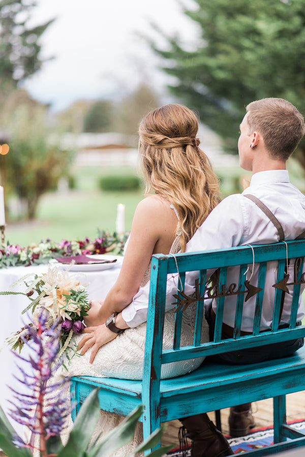 Bride and Groom Seated on Bench | Boho Wedding Inspiration | B. Jones Photography
