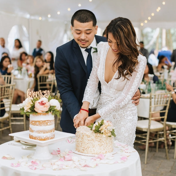 Bride and Groom Cutting Cake | A Dazzling Doughnut Wedding | Kate Aspen