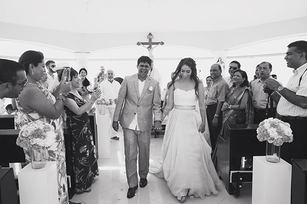 Bride and groom's exit from the chapel | Mexican Indian Fusion Wedding | Adrienne Fletcher Photography | @kateaspen