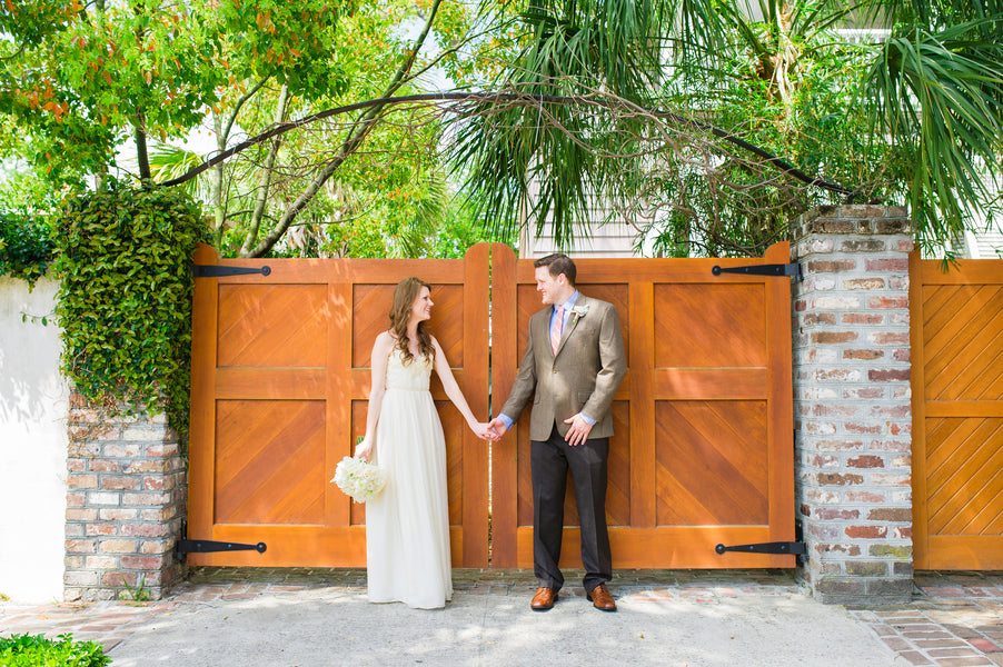 Bride and Groom Holding Hands | Peachy Pink Wedding in Historic Charleston | Priscilla Thomas Photography