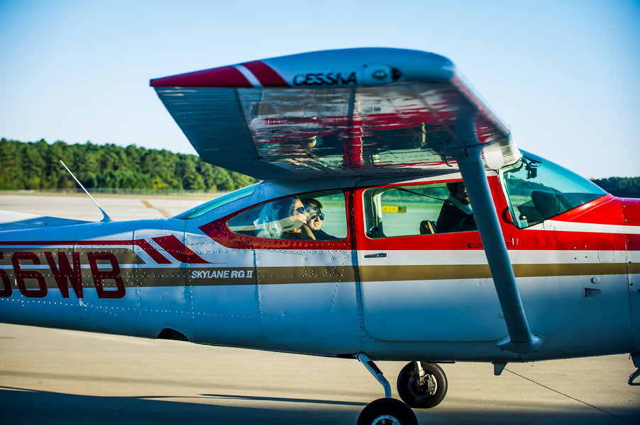 Bride and Groom In Airplane | Aviation Themed Wedding | Red Bridge Photography
