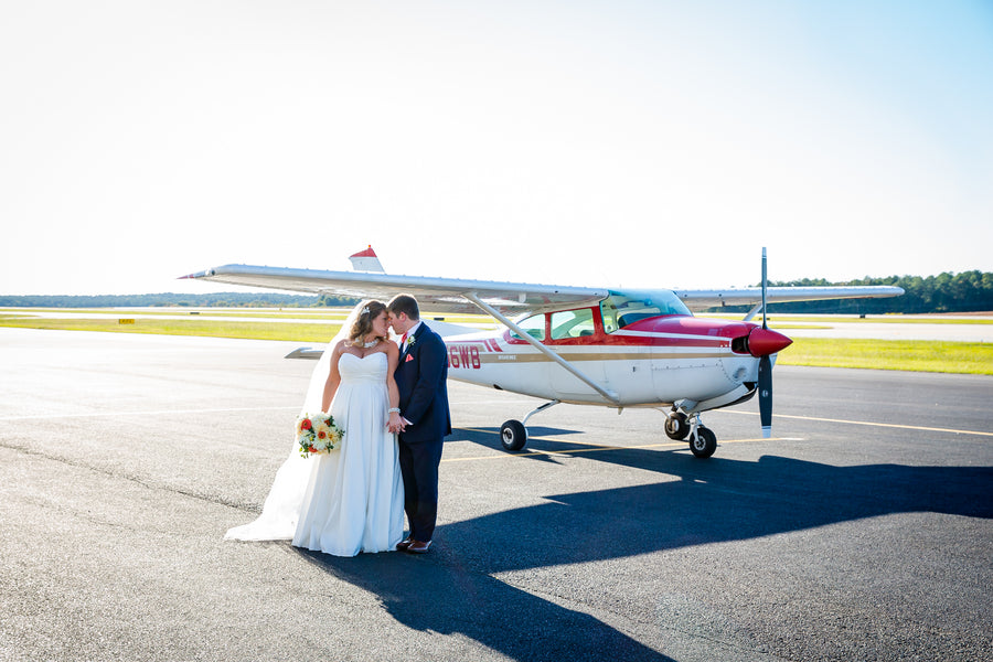 Bride and Groom In Front Of Plane | Aviation Themed Wedding | Red Bridge Photography