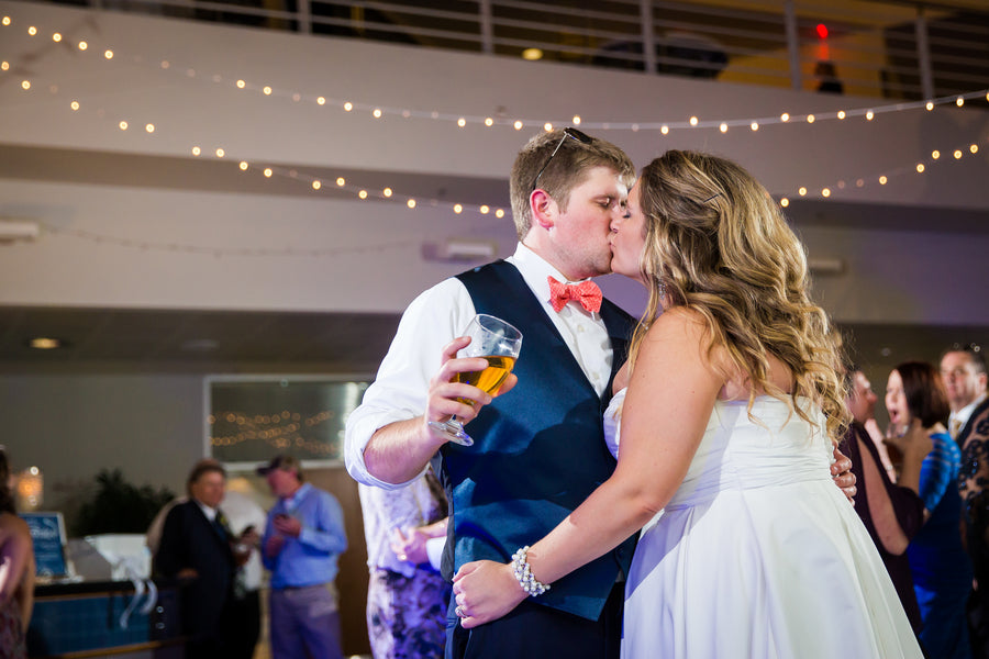 Bride and Groom Kiss At Reception | Aviation Themed Wedding | Red Bridge Photography
