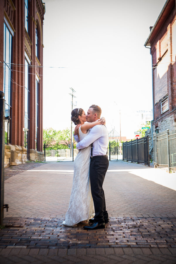 Bride and Groom Kiss | Purple Industrial Themed Wedding | Asteria Photography