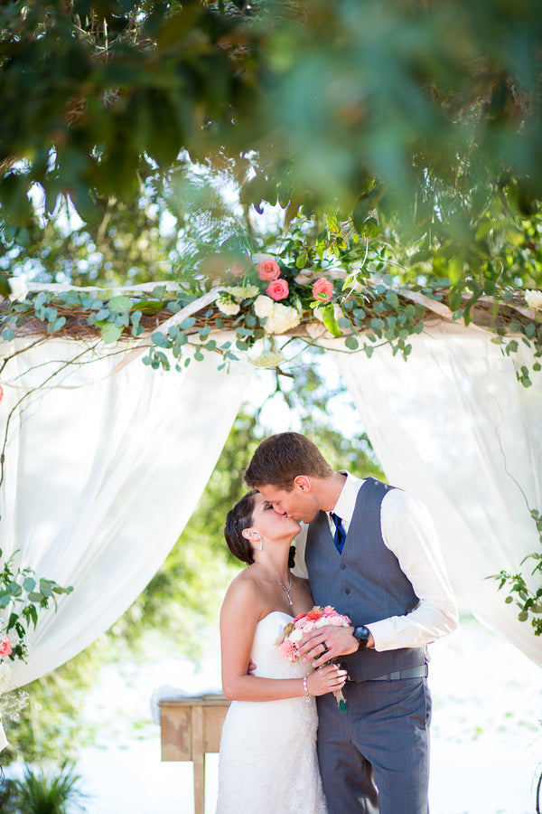 Bride and Groom Kissing At Altar | Whimsical Rustic Barn Wedding | McKenzie Stewart Weddings