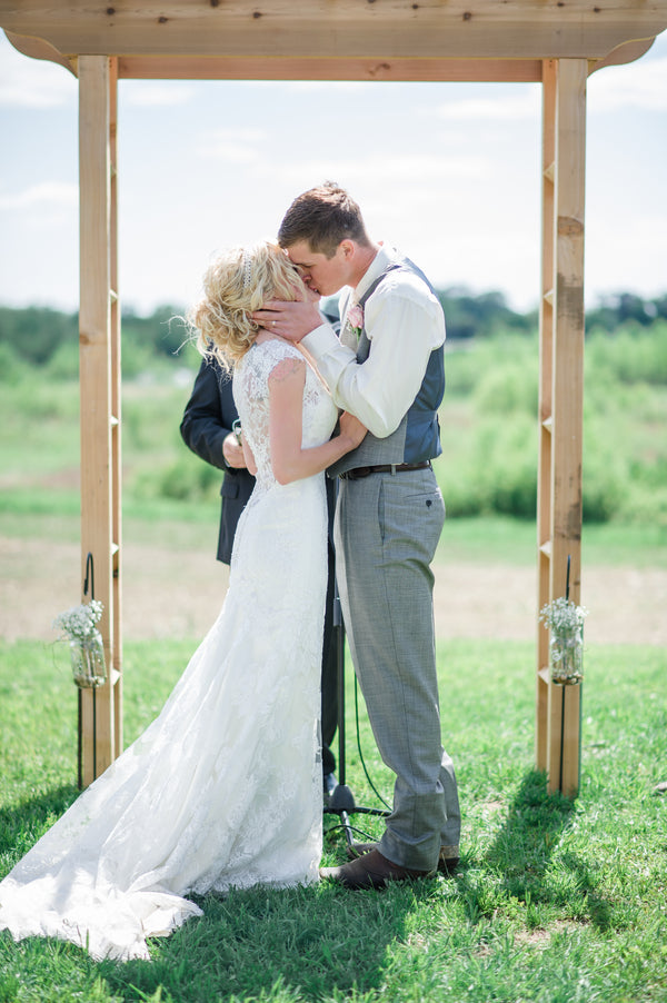 Bride and Groom Kiss  | Spring Rustic Barn Wedding | Time Into Pixels Photography
