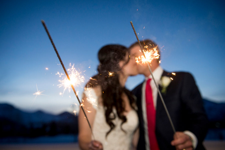 Bride and Groom Kiss with Sparklers | A Charmingly Cozy Winter Wedding | Dev Khalsa Photography | Kate Aspen