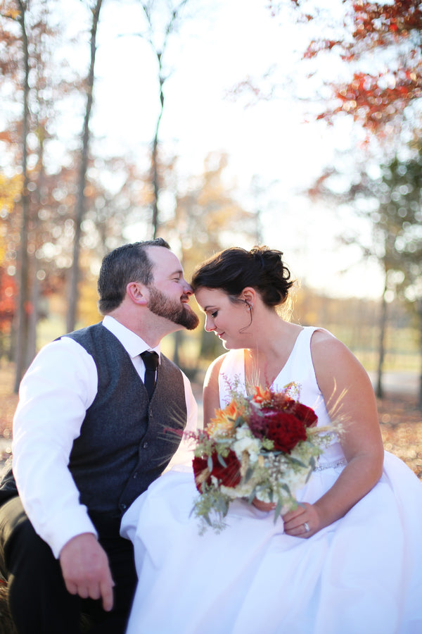 Bride and Groom Kiss | ImpressionsPhotography | A Flannel Filled Fall Wedding | Kate Aspen