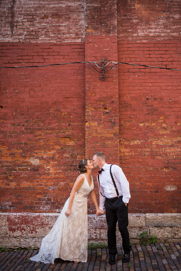 Bride and Groom Kissing | Asteria Photography | Purple Industrial Wedding