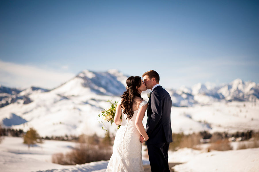 Bride and Groom Kissing In the Snow | A Charmingly Cozy Winter Wedding | Dev Khalsa Photography | Kate Aspen