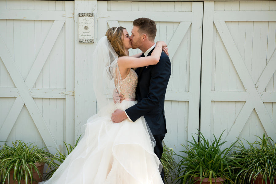 Bride and Groom Kissing | A Beautiful Blush Wedding | Kate Aspen