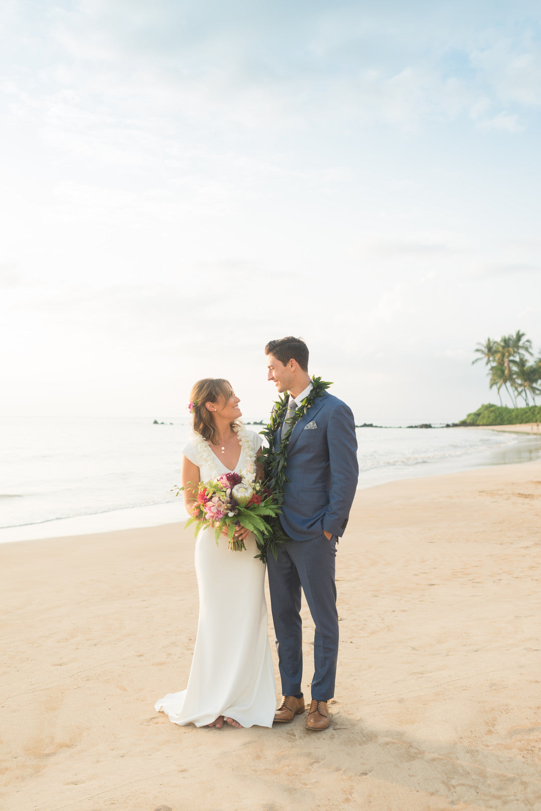 Bride and Groom Looking At Eachother On Beach | A Hawaiian Destination Wedding | Kate Aspen