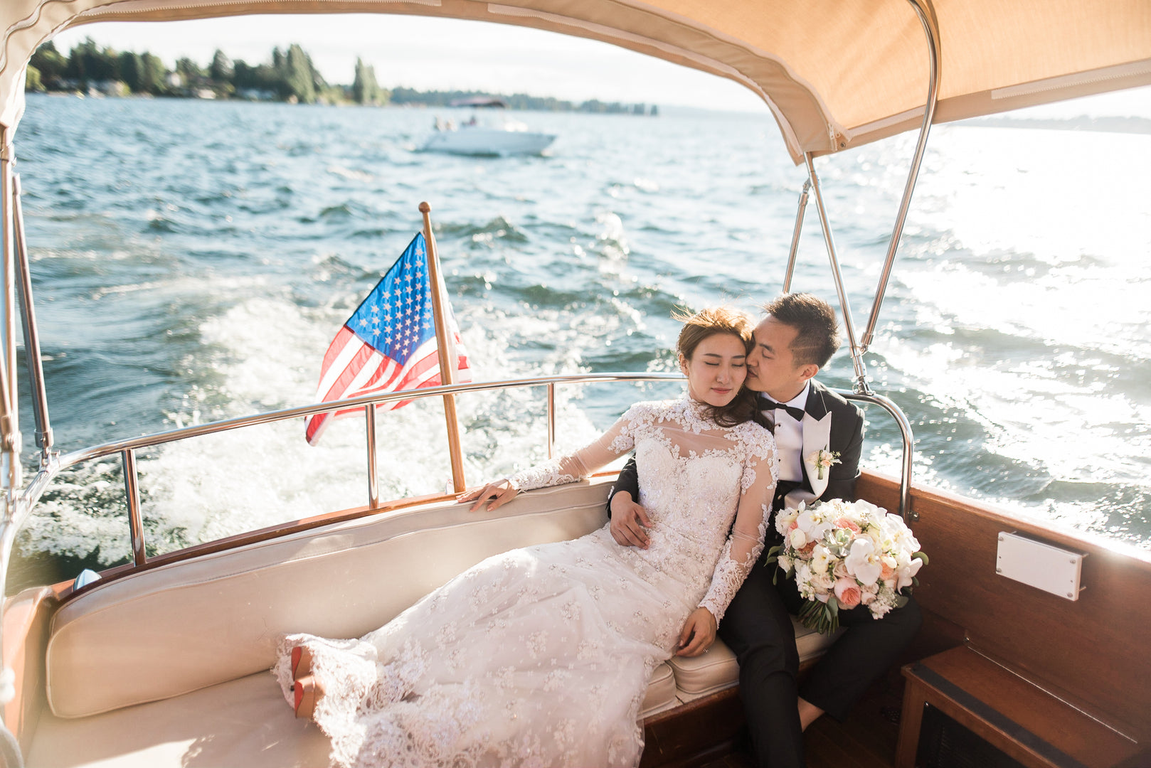 Bride and Groom On Boat | A Grand Wedding On The Water | Kate Aspen