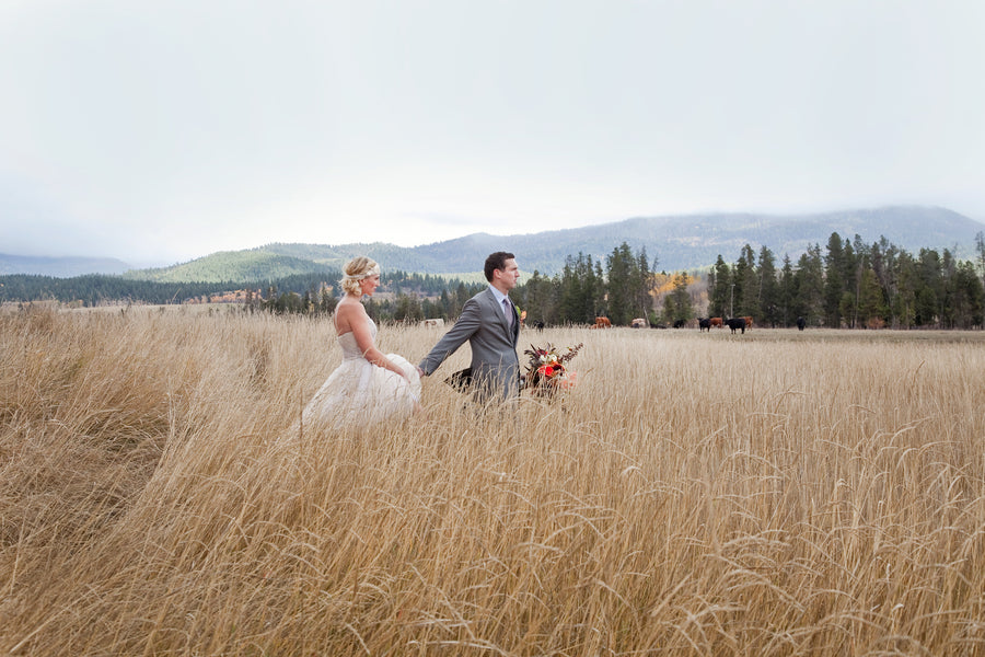 Bride and Groom Running in Field | Tana Photography LLC