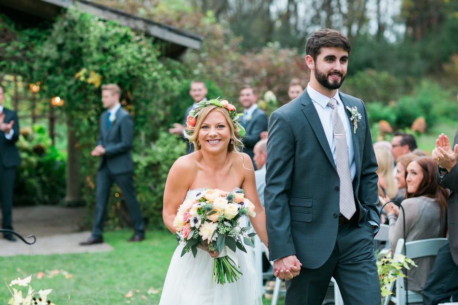 Bride and Groom Walking Down Isle | A Flowery Fall Wedding | Kate Aspen