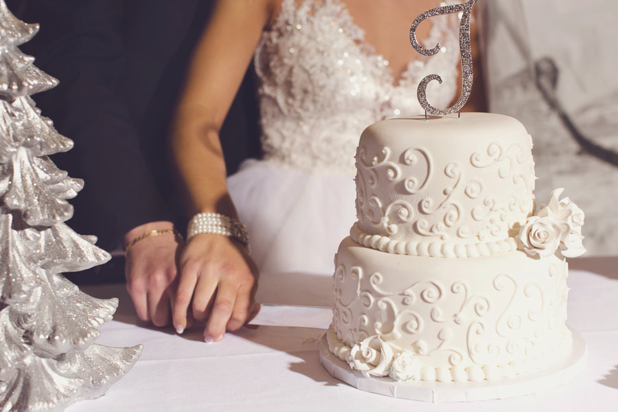 Bride and Groom With Cake | A Sparking Winter Wedding | Dana Widman Photography | Kate Aspen
