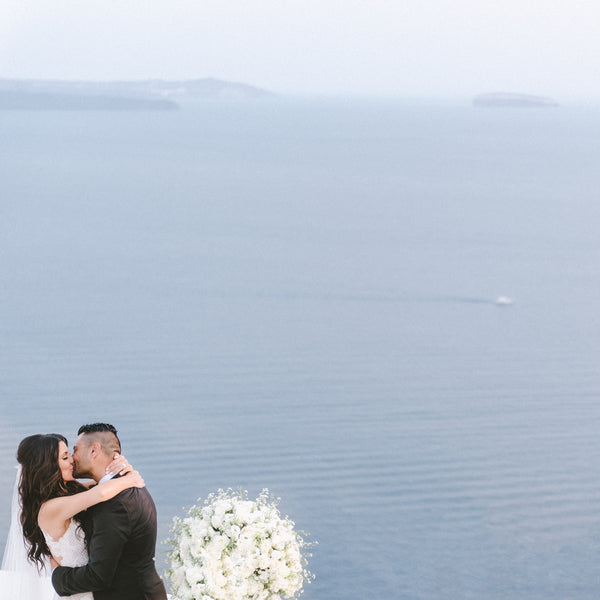 Bride and Groom in Front of Beautiful View | Santorini Destination Wedding | Vasilis Lagios Photography