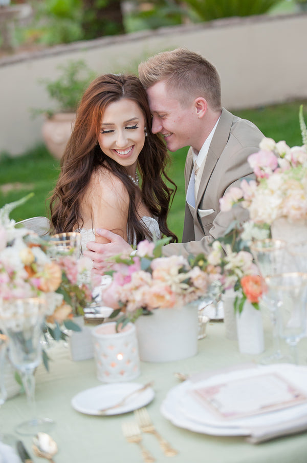 Bride and Groom Sitting at Table | Garden Wedding Shoot | Leslie Ann Photography | @kateaspen