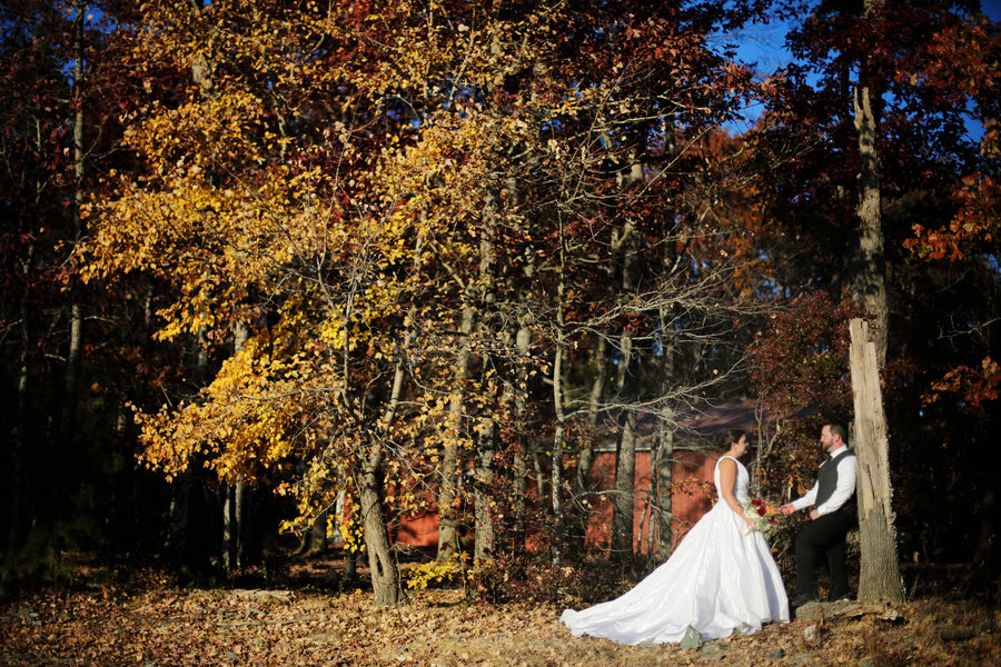 Bride and Groom in Fall Leaves | ImpressionsPhotography | A Flannel Filled Fall Wedding | Kate Aspen