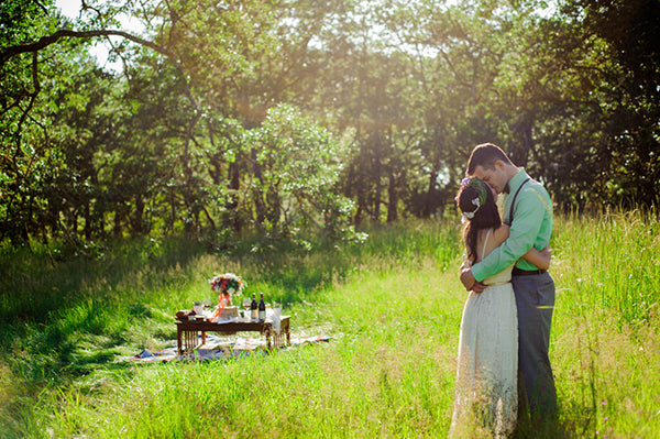 Boho Bride and Groom Kissing in Field | Rebecca Anne Photography